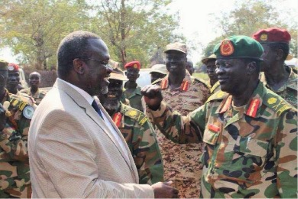 Leader of SPLM-IO, RiekMachar with commander of Special Division I, Gen James KoangCholRanley, in Pagak, 8 December 2014 (ST)